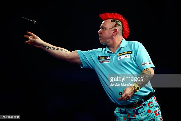 Peter Wright of Scotland in action in his third round match against Dave Chisnall of England on Day Twelve of the 2016 William Hill PDC World Darts...