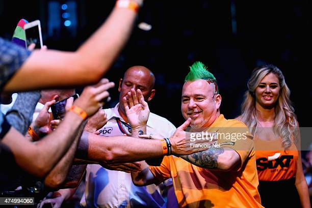 Peter Wright of Scotland makes his entrance during the 2015 Dubai Duty Free Darts Masters QuarterFinal match at Dubai Duty Free Tennis Stadium on May...