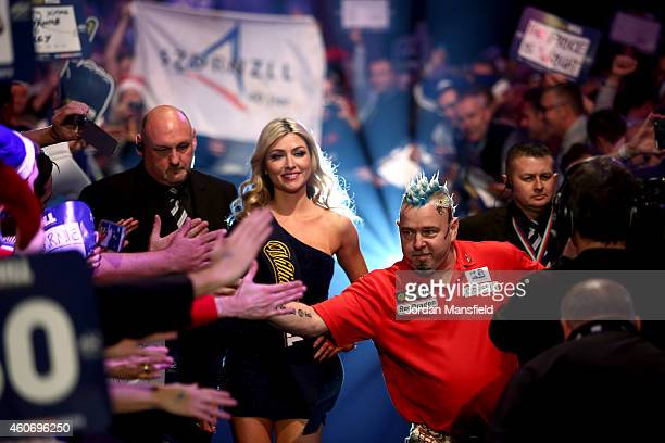Peter Wright of Scotland makes his way onto the stage prior to his first round match against Gerwyn Price of Wales on Day Two of the William Hill PDC...