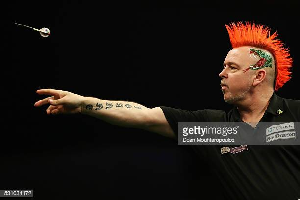 Peter Wright of Scotland plays a shot in his match against Raymond van Barneveld of the Netherlands during the Darts Betway Premier League Night 15...