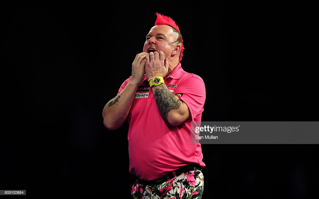 Peter Wright of Scotland reacts after missing a dart against Adrian Lewis of England in their quarter final match during Day Thirteen of the 2016...