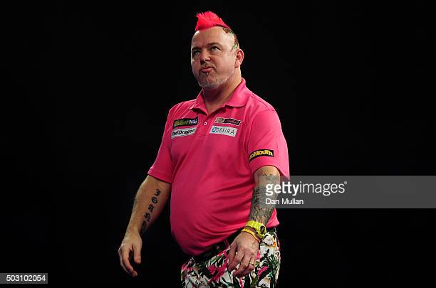 Peter Wright of Scotland reacts during his quarter final match against Adrian Lewis of England during Day Thirteen of the 2016 William Hill PDC World...