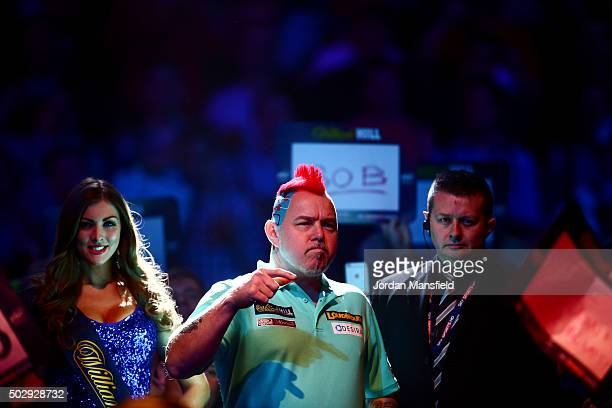 Peter Wright of Scotland walks on ahead of his third round match against Dave Chisnall of England on Day Twelve of the 2016 William Hill PDC World...
