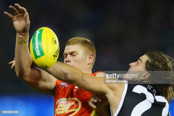 Peter Wright of the Suns and Josh Bruce of the Saints compete for the ball during the round 14 AFL match between the St Kilda Saints and the Gold...