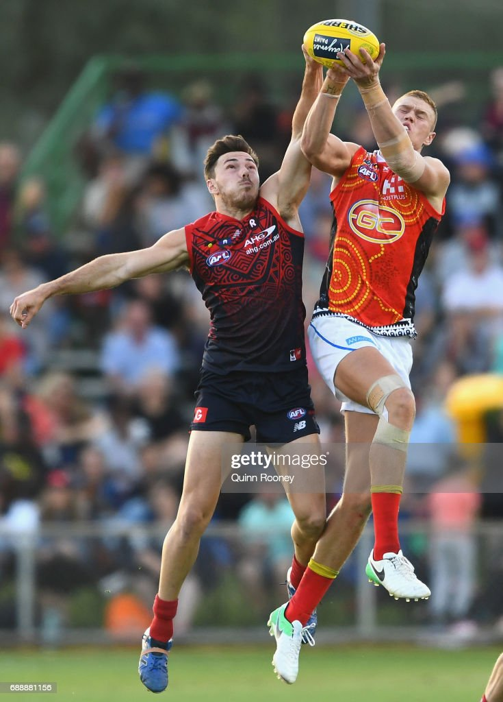 Peter Wright of the Suns marks over the top of Michael Hibberd of the Demons during the round ten AFL match between the Melbourne Demons and the Gold Coast Suns at Traeger Park on May 27, 2017 in Alice Springs, Australia.
