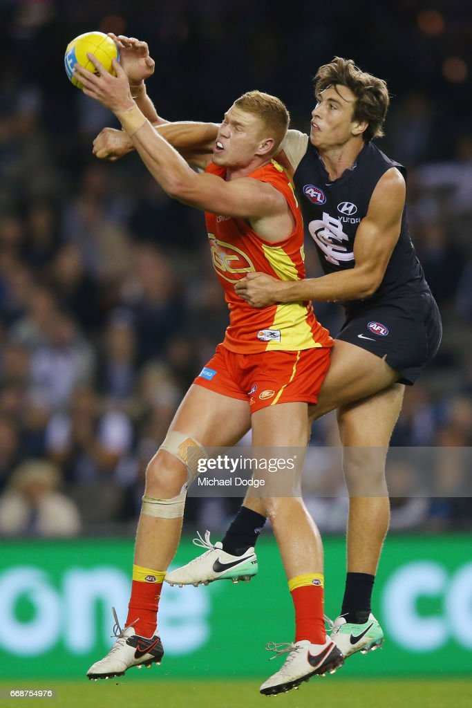 Peter Wright of the Suns marks the ball against Caleb Marchbank of the Blues during the round four AFL match between the Carlton Blues and the Gold Coast Suns at Etihad Stadium on April 15, 2017 in Melbourne, Australia.