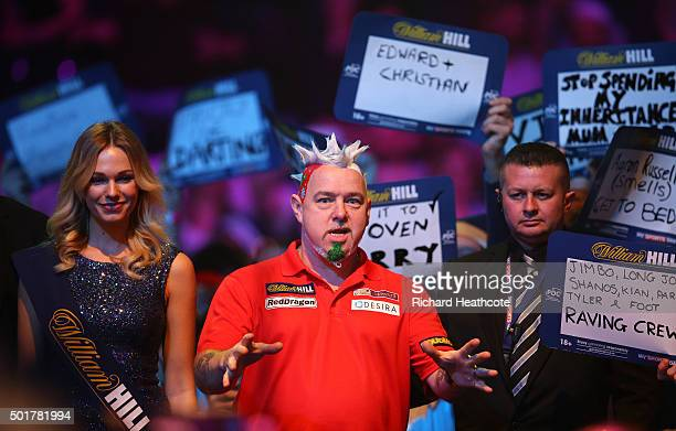 Peter Wright reacts during his first round match against Keegan Brown on day one of the 2016 William Hill PDC World Darts Championships at Alexandra...