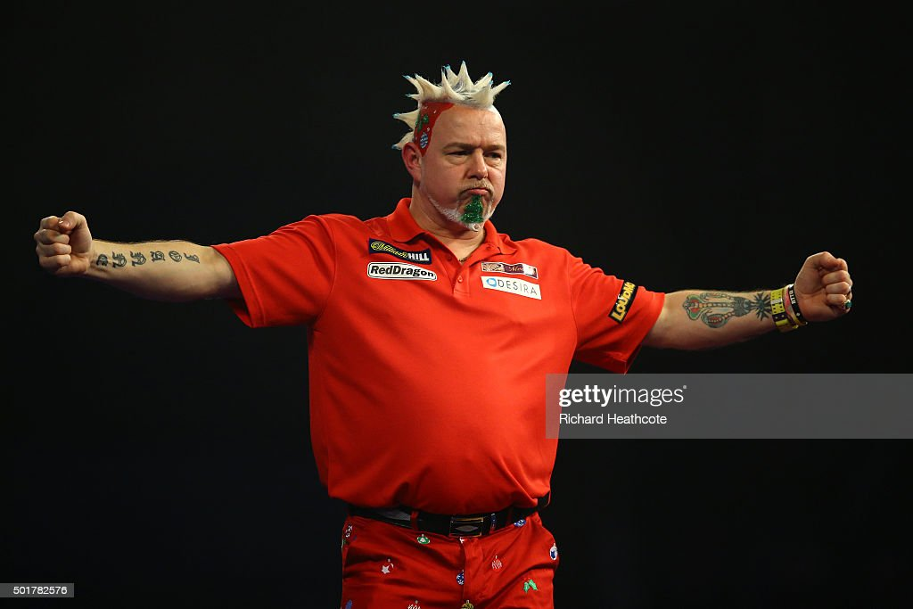 Peter Wright reacts to winning during his first round match against Keegan Brown on day one of the 2016 William Hill PDC World Darts Championships at Alexandra Palace on December 17, 2015 in London, England.