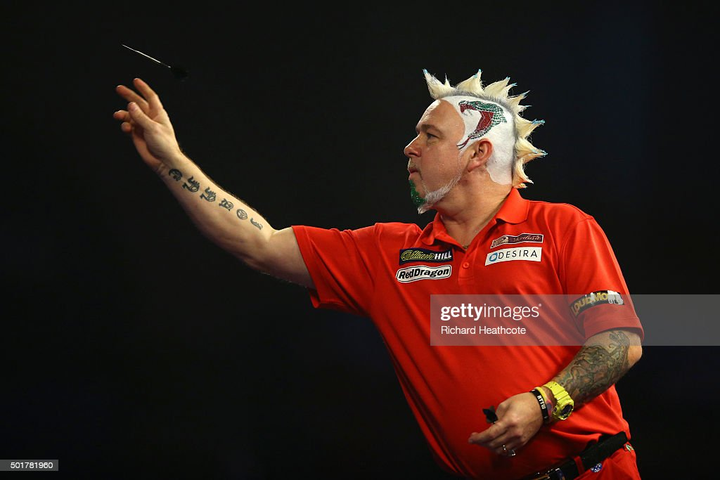 Peter Wright throws against Keegan Brown during the first round on day one of the 2016 William Hill PDC World Darts Championships at Alexandra Palace on December 17, 2015 in London, England.