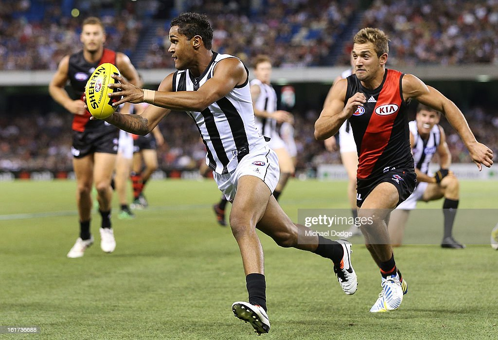Peter Yagmoor of the Collingwood Magpies runs with the ball during the round one AFL NAB Cup match between the Collingwood Magpies and the Essendon Bombers at Etihad Stadium on February 15, 2013 in Melbourne, Australia.