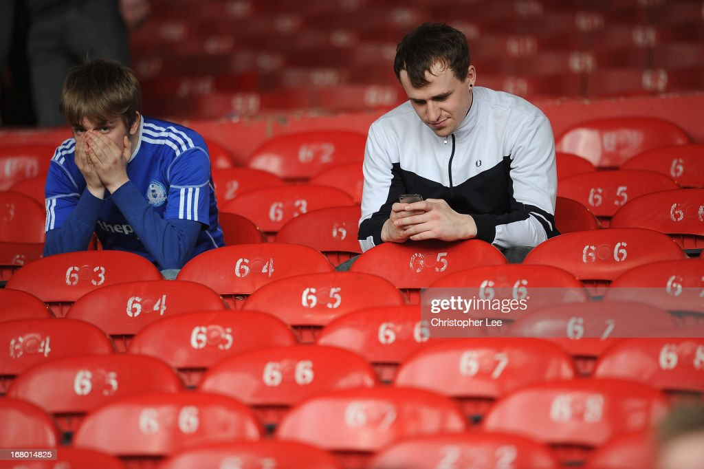 Peterborough fans look dejected as they are relegated during the npower Championship match between Crystal Palace and Peterborough United at Selhurst Park on May 04, 2013 in London, England.