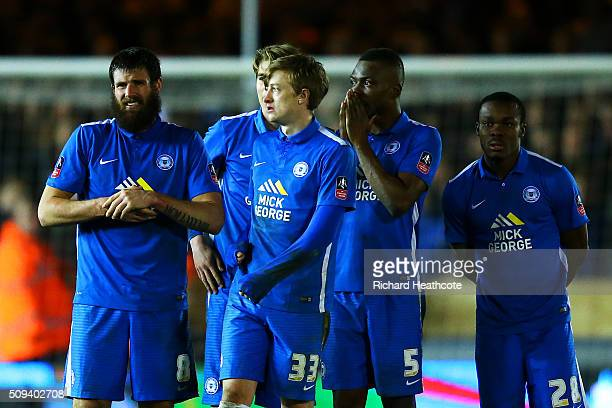 Peterborough players reacts during the penalty shootout in the Emirates FA Cup fourth round replay match between Peterborough United and West...