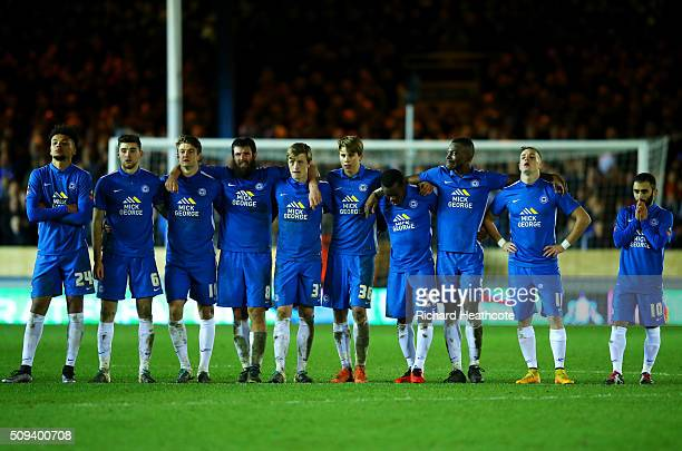Peterborough players watch the penalty shootout from the centre circle during the Emirates FA Cup fourth round replay match between Peterborough...