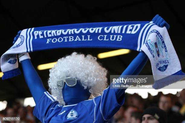 A Peterborough United fan in fancy dress show his support in the stands
