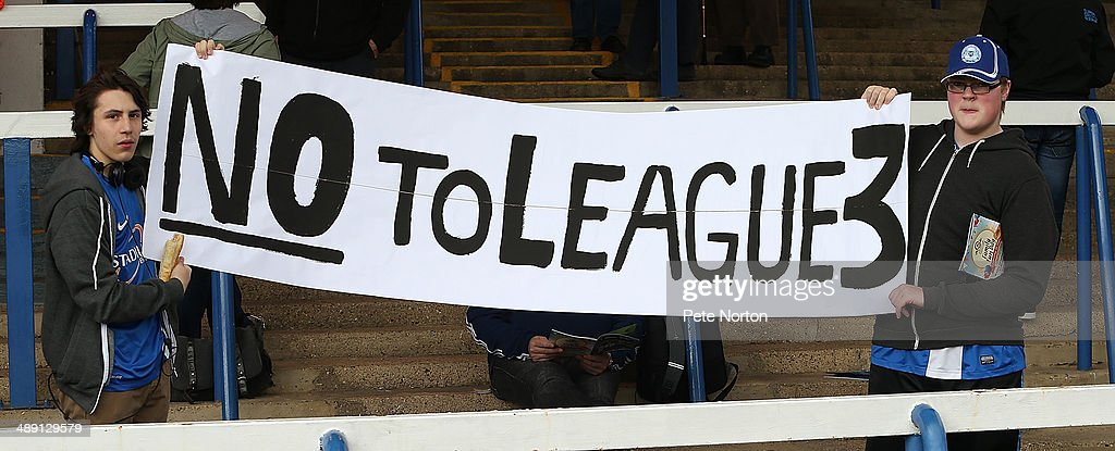 Peterborough United fans hold a banner to protest at the possible inclusion of League 3 into the Football League during the Sky Bet League One Semi Final First Leg between Peterborough United and Leyton Orient at London Road Stadium on May 10, 2014 in Peterborough, England.