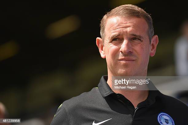 Peterborough United manager Dave Robertson looks on during the pre season friendly match between Peterborough United and a Tottenham Hotspur XI at...