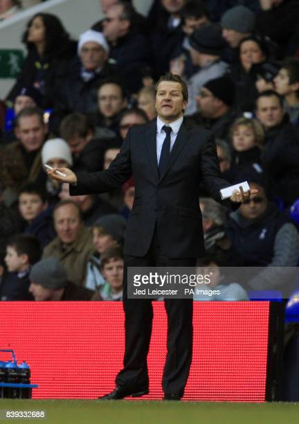 Peterborough United manager Mark Cooper shrugs his shoulders on the touchline during the FA Cup Third Round match at White Hart Lane London