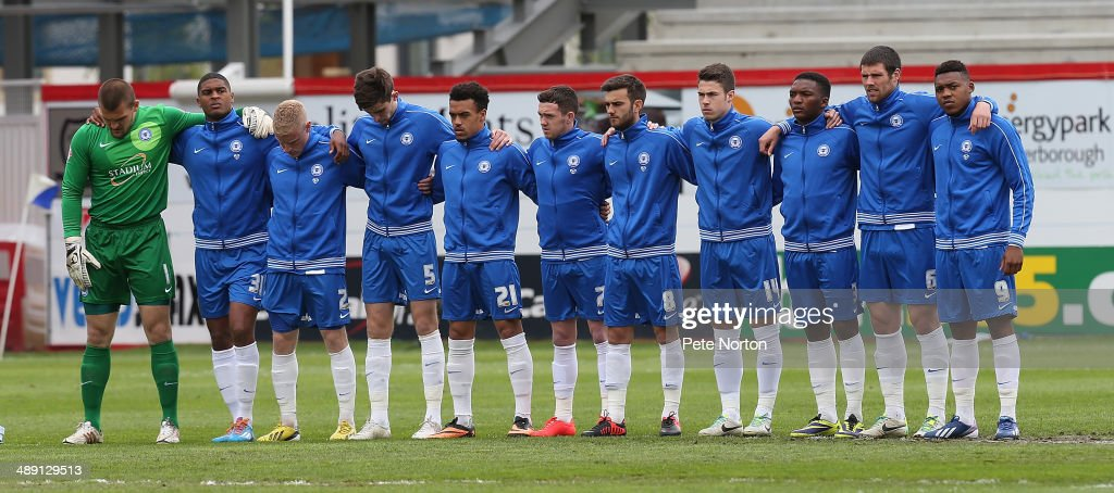 Peterborough United players observe a minutes silence to mark the 29th anniversary of the Bradford Fire prior to the Sky Bet League One Semi Final First Leg between Peterborough United and Leyton Orient at London Road Stadium on May 10, 2014 in Peterborough, England.