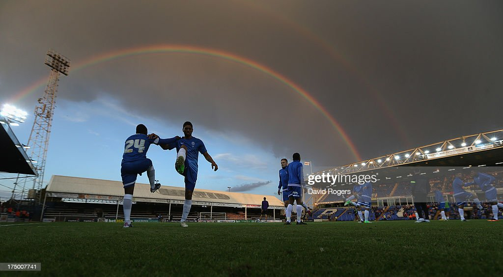 Peterborough United players warm up at half time underneath a rainbow during the pre season friendly match between Peterborough United and Hull City at London Road Stadium on July 29, 2013 in Peterborough, England.
