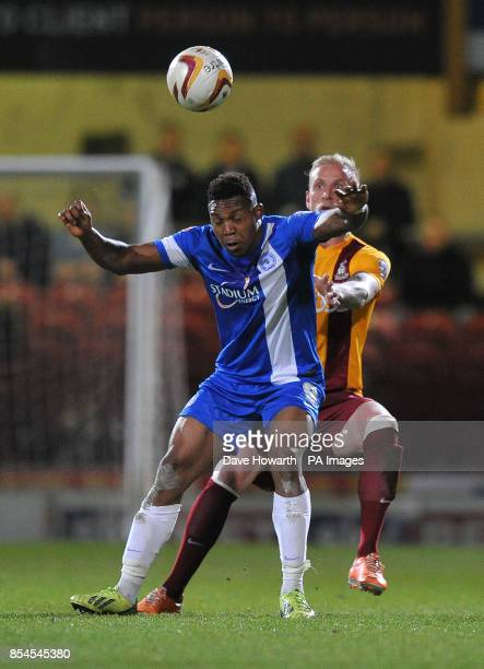 Peterborough United's Britt Assombalonga and Bradford City's Andrew Davies battle for the ball during the Sky Bet League One match at the Coral...