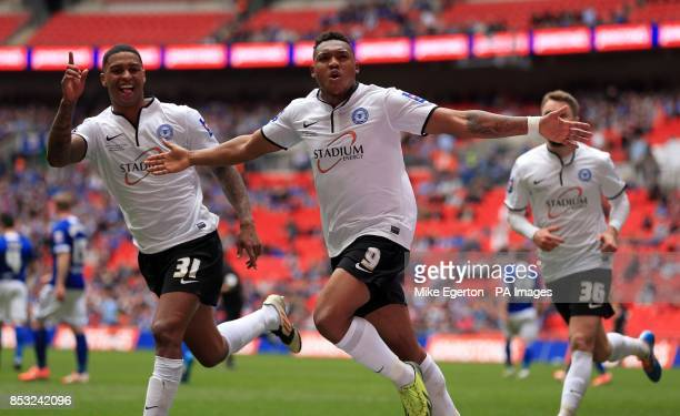 Peterborough United's Britt Assombalonga celebrates scoring their third goal from the penalty spot during the Johnstone's Paint Trophy Final at...