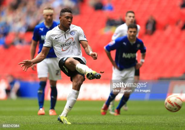 Peterborough United's Britt Assombalonga scores their third goal from the penalty spot during the Johnstone's Paint Trophy Final at Wembley Stadium...