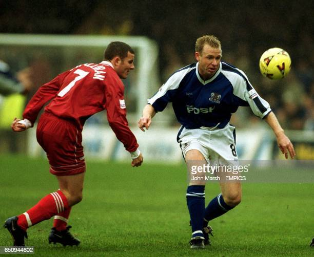Peterborough United's David Oldfield and Swindon Town's Keith O'Halloran fight for the ball