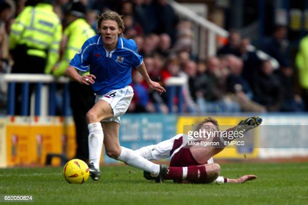 Peterborough United's Jimmy Bullard goes past Northampton Town's Marco Gabbiadini