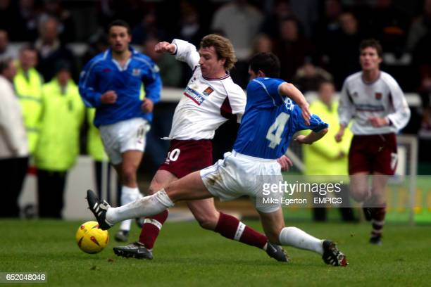 Peterborough United's Mark Arber tackles Northampton Town's Marco Gabbiadini