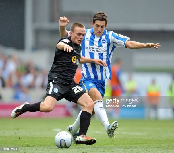 Peterborough United's Paul Taylor and Brighton and Hove Albion's Lewis Dunk
