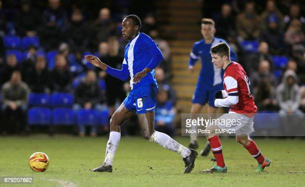 Peterborough United's Tarik MooreAzille holds off challenge from Arsenal's Daniel Crowley