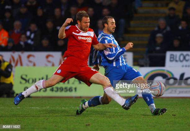 Peterborough's Kelvin Langmead takes on Brighton's Glenn Murray during the npower League One match at the Withdean Stadium Brighton