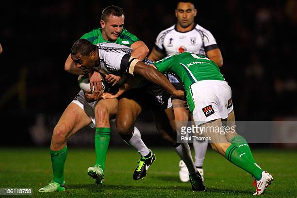 Petero Civoniceva of Fiji is tackled by Ireland's Ben Currie and James Mendeika during the Rugby League World Cup Group A match between Fiji and...