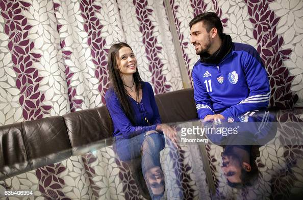 Peterson Silvino da Cruz of Brazilian football club Fluminense FC talks with his wife Marcella in their apartment after a training session in Samorin...