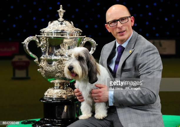 A Petit Basset Griffon Vendeen named Jilly with owner Gavin Robertson from Wallingford Oxfordshire after winning Best in Show at Crufts 2013 NEC...