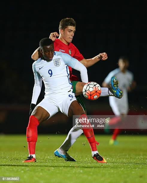 Petko Hristov of Bulgaria U19 and Stephy Mavididi of England U19 during the U19 International match between England and Bulgaria at Adams Park on...