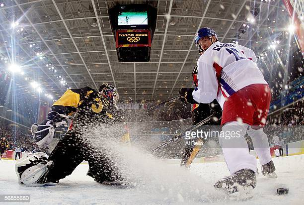 Petr Cajanek of the Czech Republic tries to kick the puck in the goal in front of goalie Olaf Kolzig of Germany during the men's ice hockey...