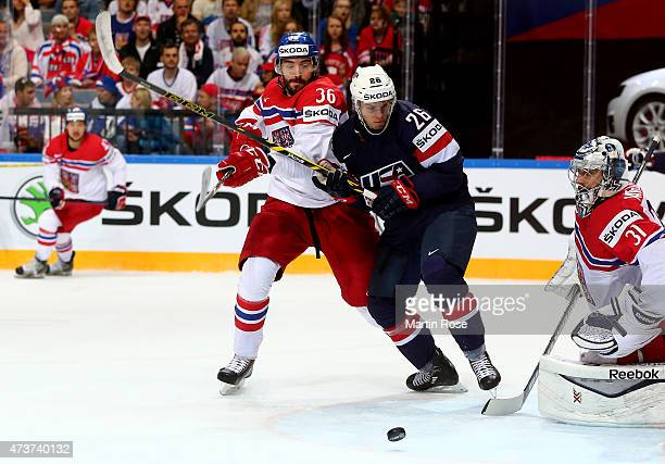 Petr Caslava of Czech Republic and Jeremy Morin of USA battle for the puck during the IIHF World Championship bronze medal match between Crech...