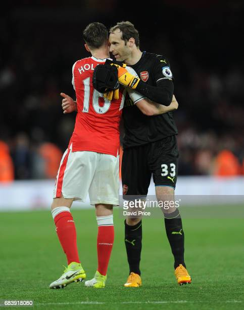 Petr Cech and Rob Holding of Arsenal after the Premier League match between Arsenal and Sunderland at Emirates Stadium on May 16 2017 in London...