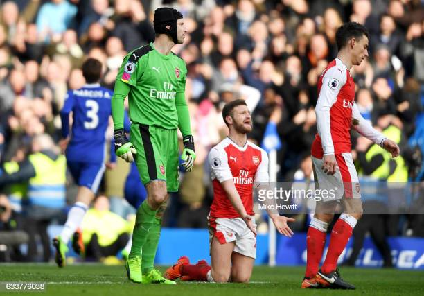Petr Cech and Shkodran Mustafi of Arsenal react after conceding a second goal scored by Eden Hazard of Chelsea during the Premier League match...