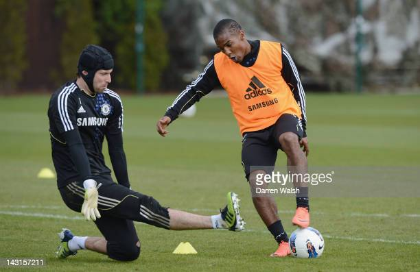 Petr Cech Florent Malouda of Chelsea during a training session at the Cobham training ground on April 20 2012 in Cobham England