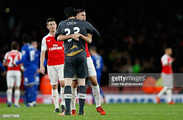 Petr Cech of and Gabriel of Arsenal celebrate their team's 21 win in the Barclays Premier League match between Arsenal and Everton at Emirates...