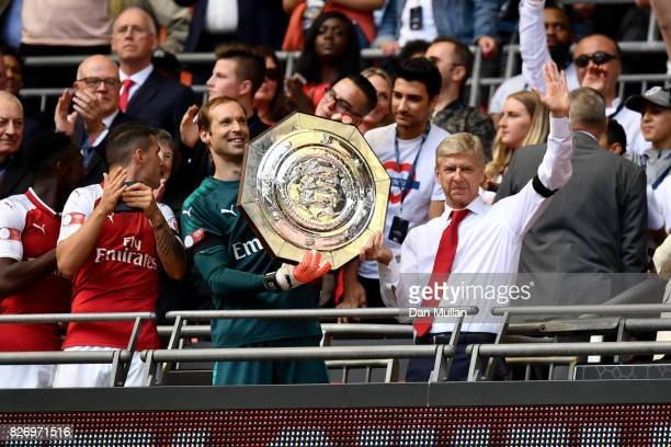 Petr Cech of Arsenal and Arsenal manager Arsene Wenger celebrate with the trophy following the The FA Community Shield final between Chelsea and...