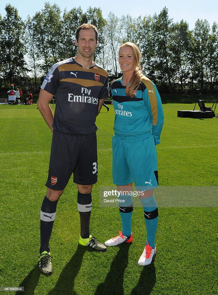 Petr Cech of Arsenal and Emma Byrne of Arsenal Ladies during the Arsenal 1st Team Group Photograph at London Colney on September 10, 2015 in St Albans, England.