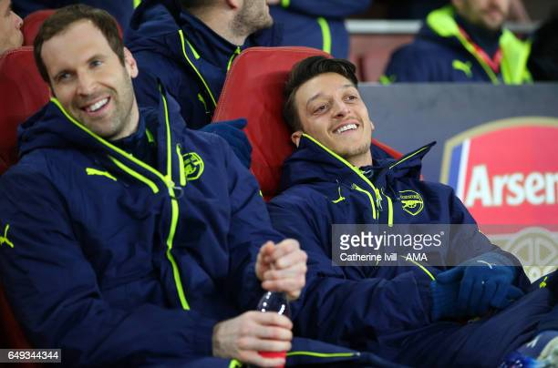 Petr Cech of Arsenal and Mesut Ozil of Arsenal are all smiles before the UEFA Champions League Round of 16 second leg match between Arsenal FC and FC...
