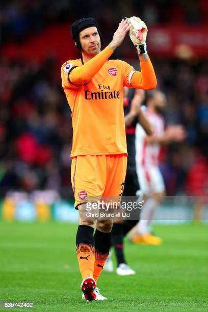 Petr Cech of Arsenal applauds the supporters following the Premier League match between Stoke City and Arsenal at Bet365 Stadium on August 19 2017 in...