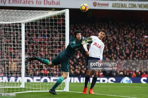Petr Cech of Arsenal battles with Dele Alli of Tottenham Hotspur during the Premier League match between Arsenal and Tottenham Hotspur at Emirates...