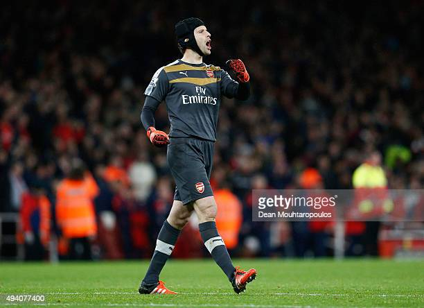 Petr Cech of Arsenal celebrates his team's 21 win in the Barclays Premier League match between Arsenal and Everton at Emirates Stadium on October 24...
