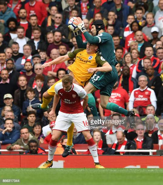 Petr Cech of Arsenal claims the ball ahead of Shane Duffy of Brighton during the Premier League match between Arsenal and Brighton and Hove Albion at...