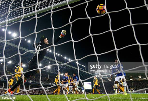 Petr Cech of Arsenal dives in vain as Ashley Williams of Everton scores his team's second goal during the Premier League match between Everton and...